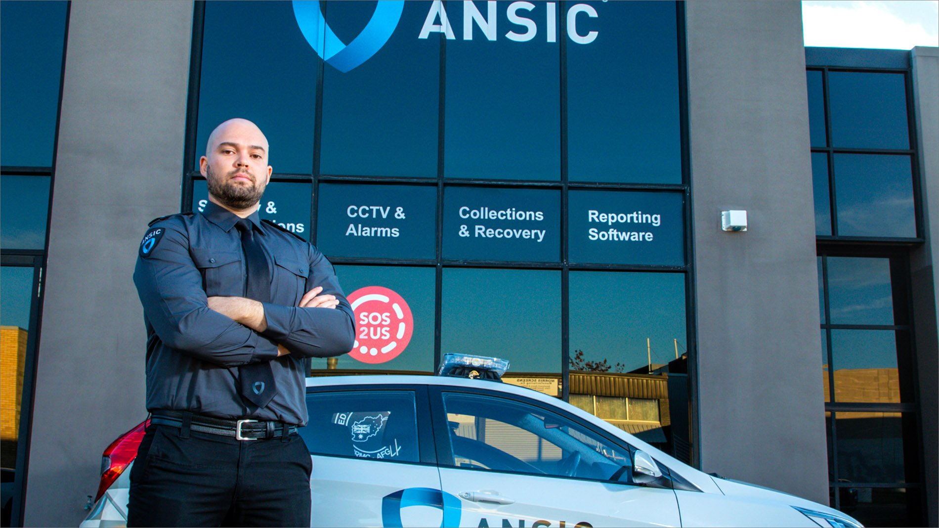 ANSIC Security Guard in Front of a Service Car